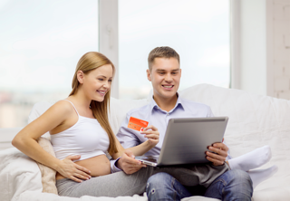 expecting-family-with-laptop-and-credit-card-000060439762_Large.png